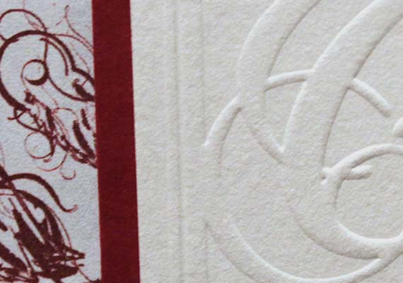A custom logo was created and embossed upon multiple surfaces.